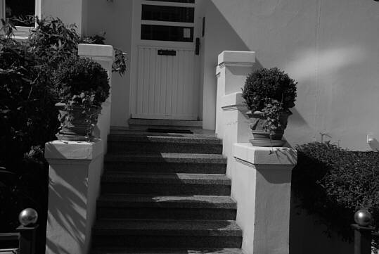 stairs to the entrance of a villa-like townhouse