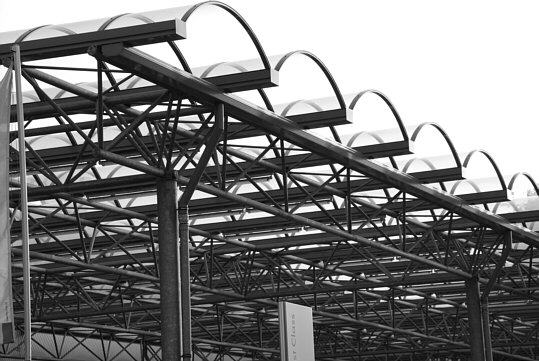 a part of an extended canopy which is in front of the greater part of the façade of a car dealership
