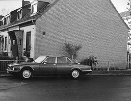 A big Jaguar sedan in a turning area in our estate of terraced houses